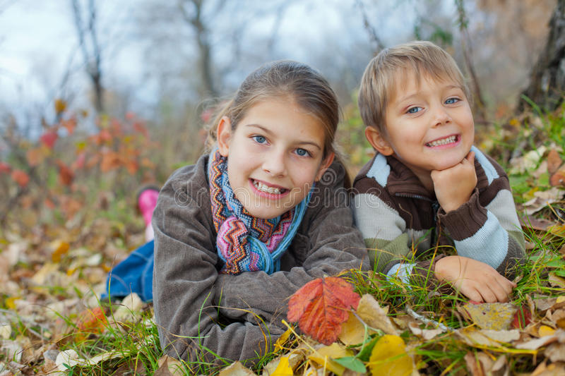 Kids In Autumn Park Royalty Free Stock Images