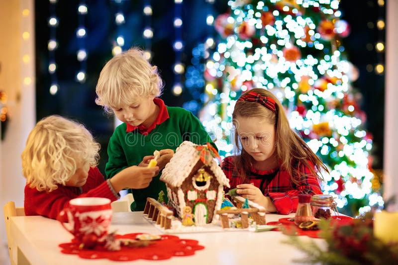 Kids baking gingerbread house. Christmas at home stock image