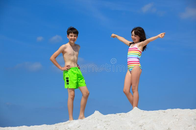 Kids in bathing suits on beach stock photography