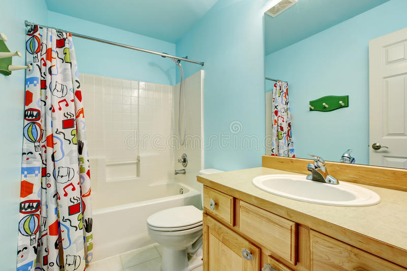 Download Kids Bathroom In Blue Tones With Wooden Cabinets And Colorful  Shower Curtain. Stock Illustration