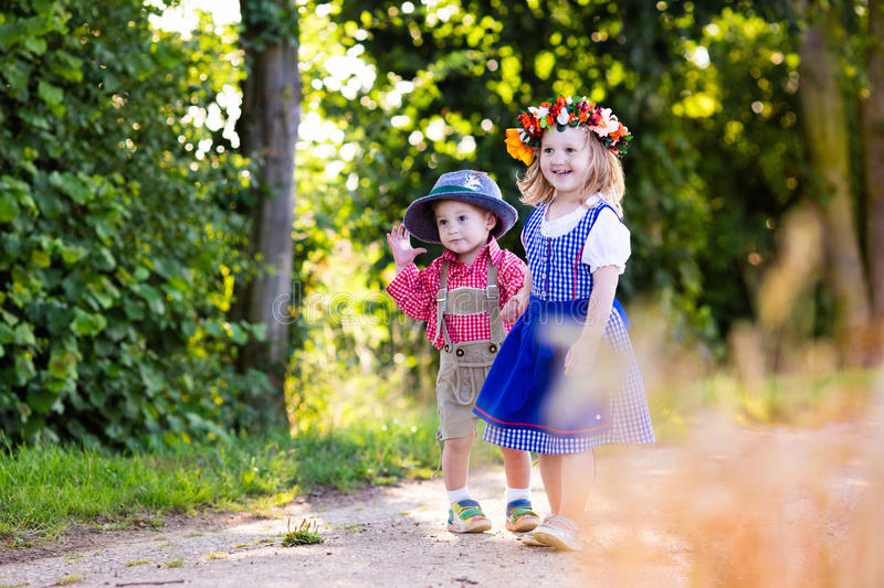 Kids in Bavarian costumes in wheat field stock image