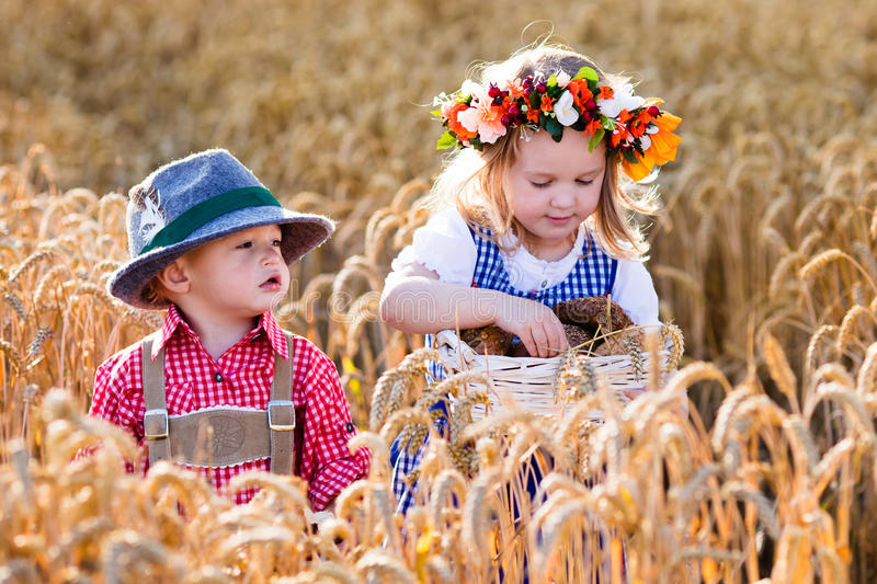 Kids in Bavarian costumes in wheat field royalty free stock photo