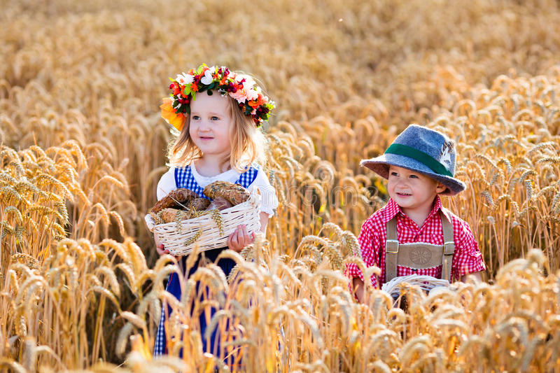 Kids in Bavarian costumes in wheat field stock photography