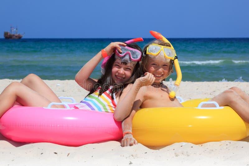 Kids on the beach stock photo