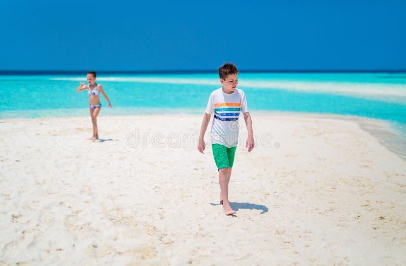 Kids at beach stock photo