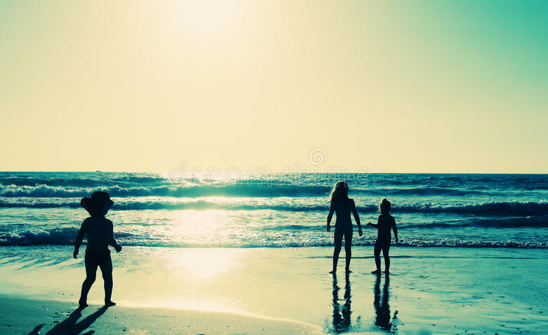 Kids on the beach royalty free stock photography