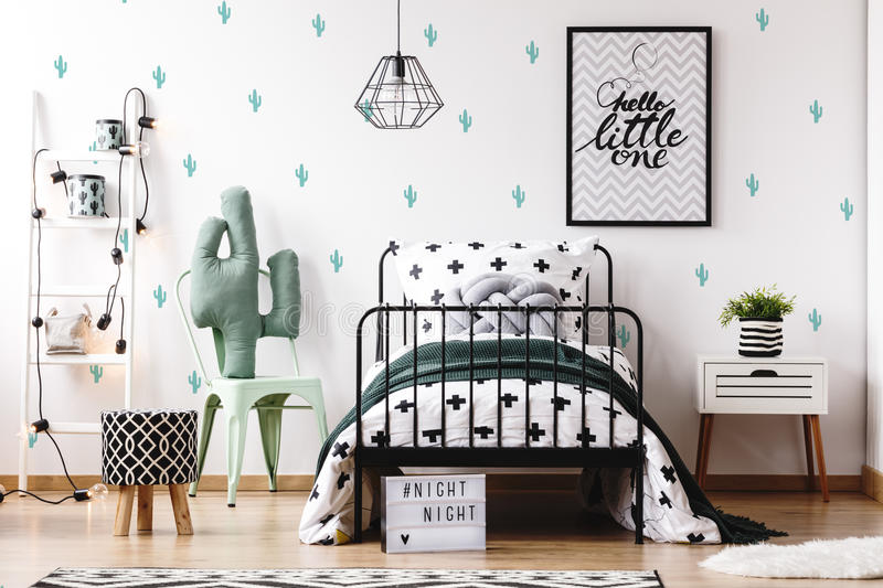 Kids bedroom with cute wallpaper. Pattern stool on wood floor and accessories on white ladder in kids bedroom with cute wallpaper royalty free stock photography