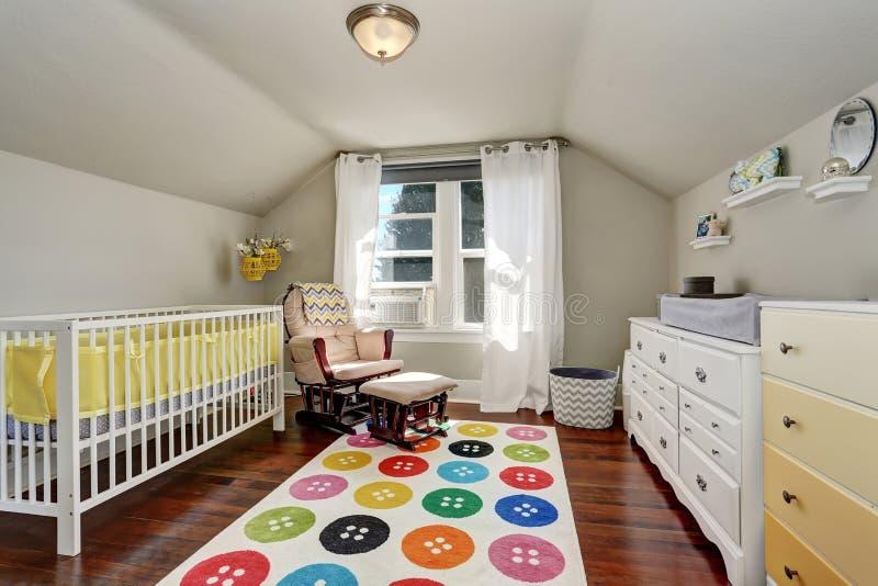 Kids bedroom with nice crib and colorful rug stock image