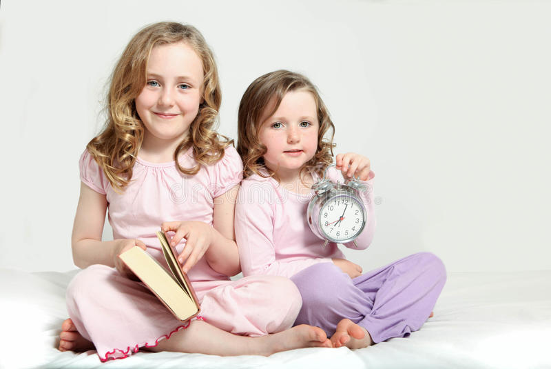 Kids bedtime routine, story book. Kids bedtime routine, story book and alarm clock stock image