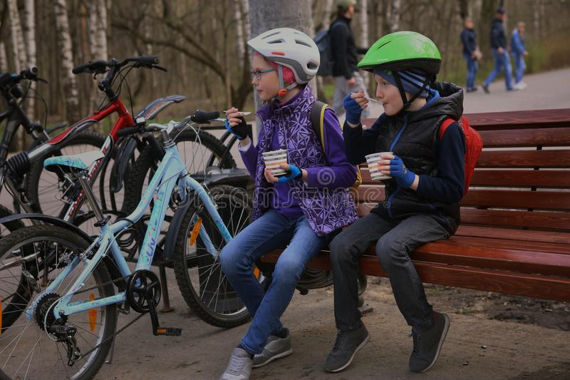Kids with bicycles eat ice-cream royalty free stock photography