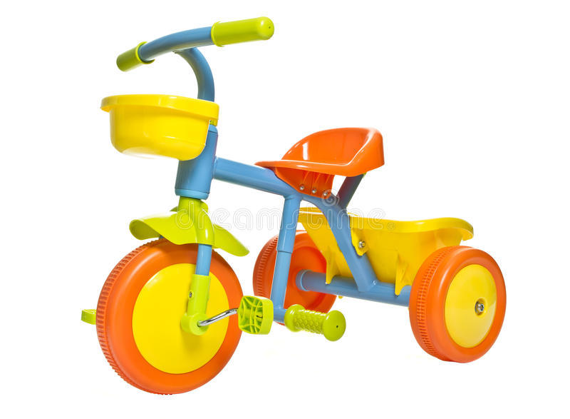 Kids bike. Vibrant childs 1st bike / trike isolated on white royalty free stock photos