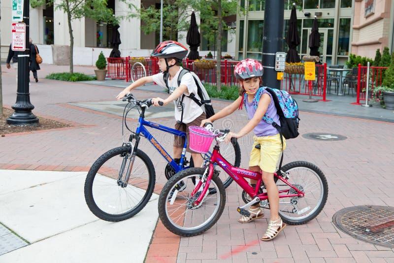 Kids Biking to School. May 9, 2012 - Arlington, Virginia, USA - National Bike to School Day, Key School Escuela Key Elementary stock photo