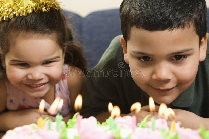 Kids and birthday cake. royalty free stock photos
