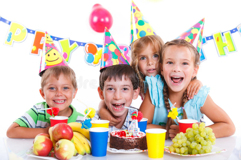 Kids with birthday cake. Group of adorable kids having fun at birthday party with birthday cake stock photo