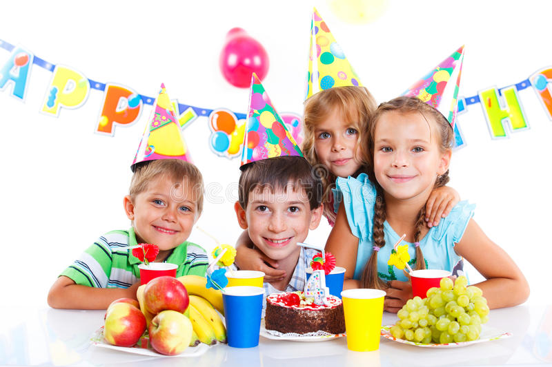 Kids with birthday cake. Group of adorable kids having fun at birthday party with birthday cake royalty free stock image