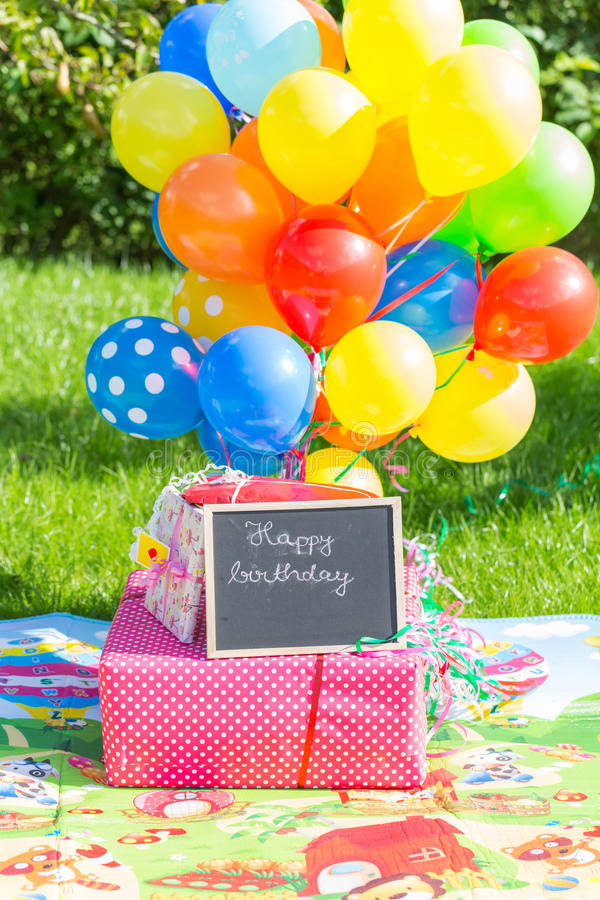 Kids birthday celebration concept. With presents and balloons stock photo