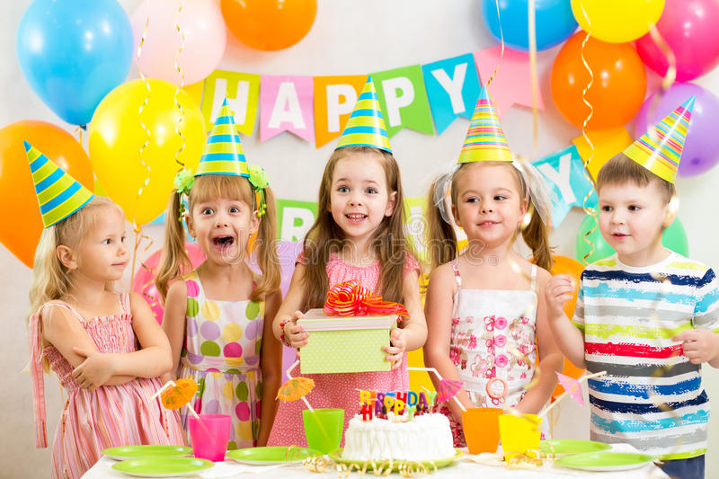 Kids on birthday party royalty free stock images