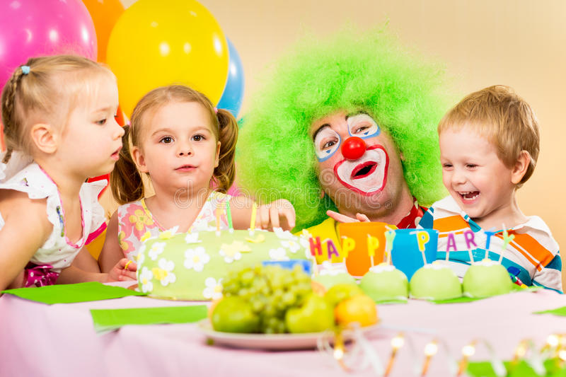Kids on birthday party with clown royalty free stock photography