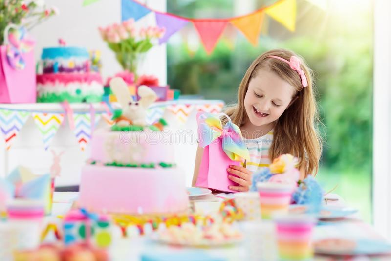 Kids birthday party. Child with cake and presents. stock images