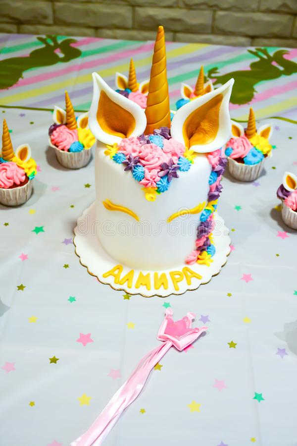 Unicorn party cupcake and cake stock images