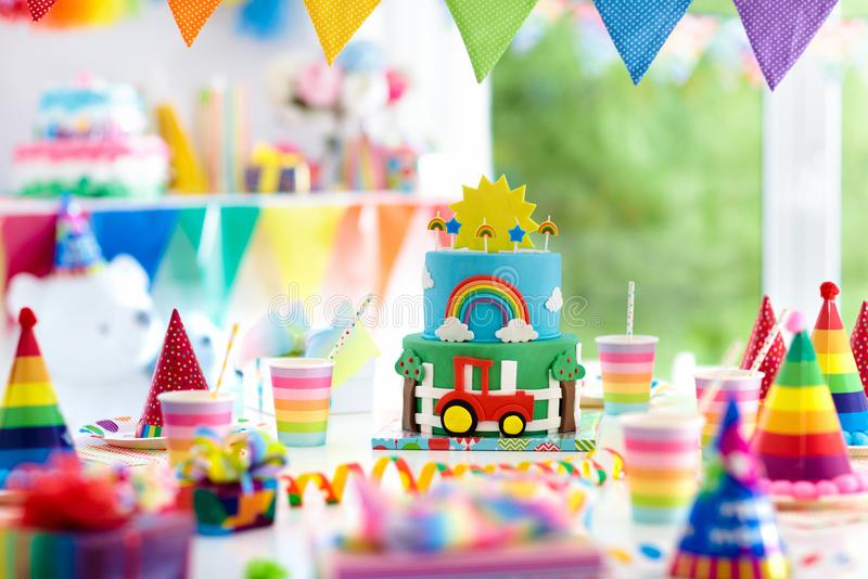Boy birthday. Cake for little child. Kids party. Kids birthday party decoration. Colorful cake with candles. Farm and transportation theme boys party. Decorated stock image