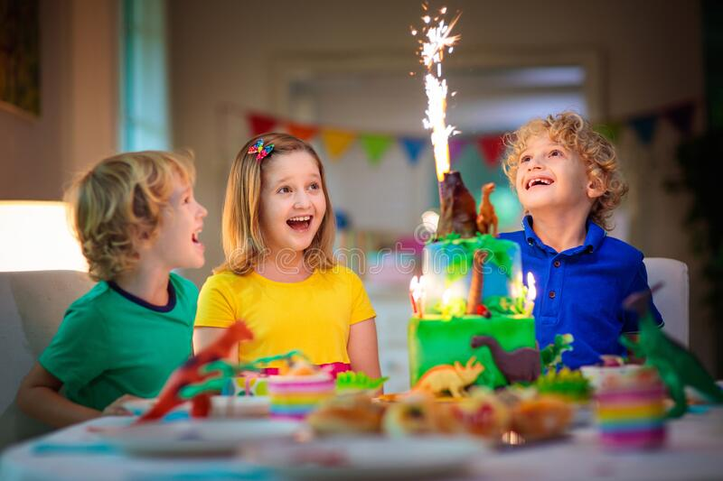 Kids birthday party. Dinosaur theme cake stock photo