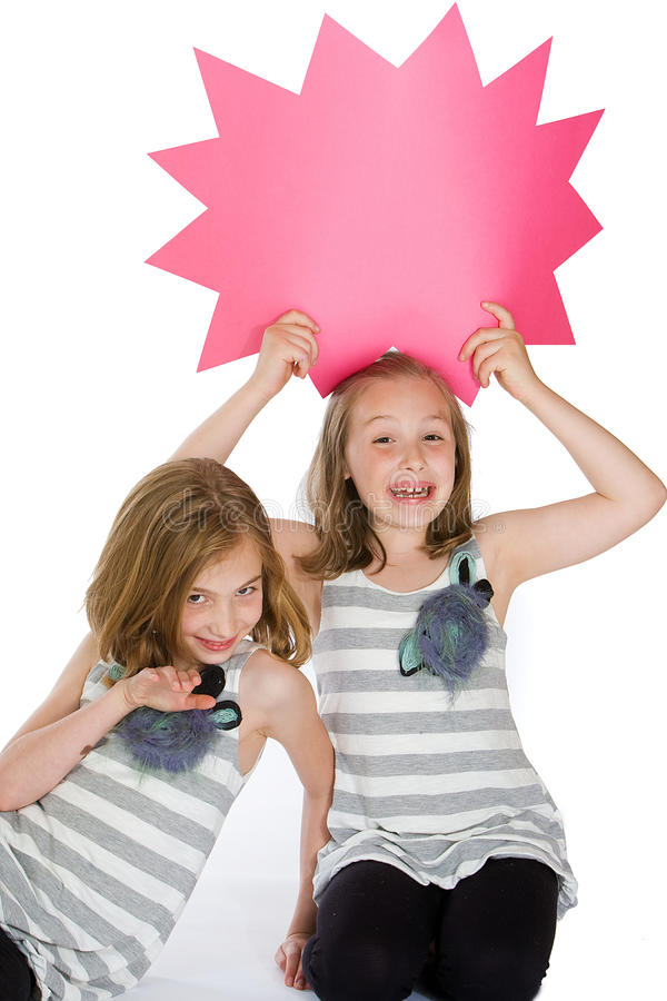 Kids With A Blank Message Sign Royalty Free Stock Images