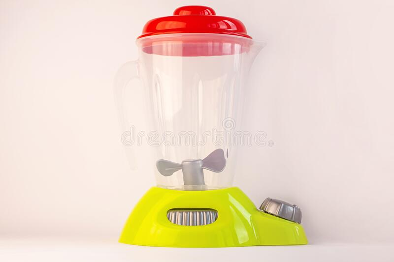 Kids blender on a white background. Childs food toy. Healthy eating, raw vegan diet, playing with babies.Healthy eating stock image