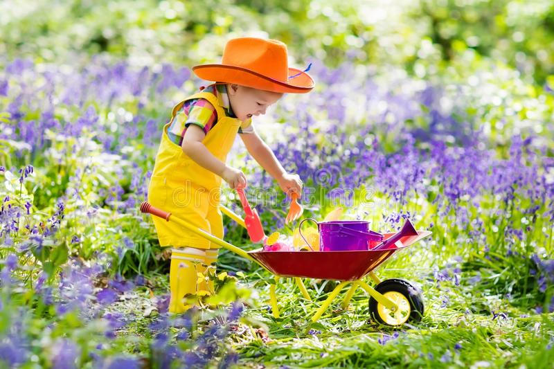 Kids in bluebell garden royalty free stock images