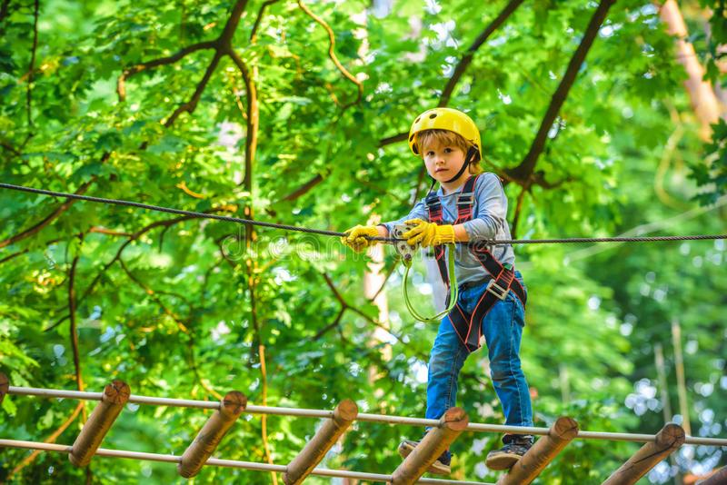 Kids boy adventure and travel. Adventure climbing high wire park. Early childhood development. Cute child in climbing stock photos