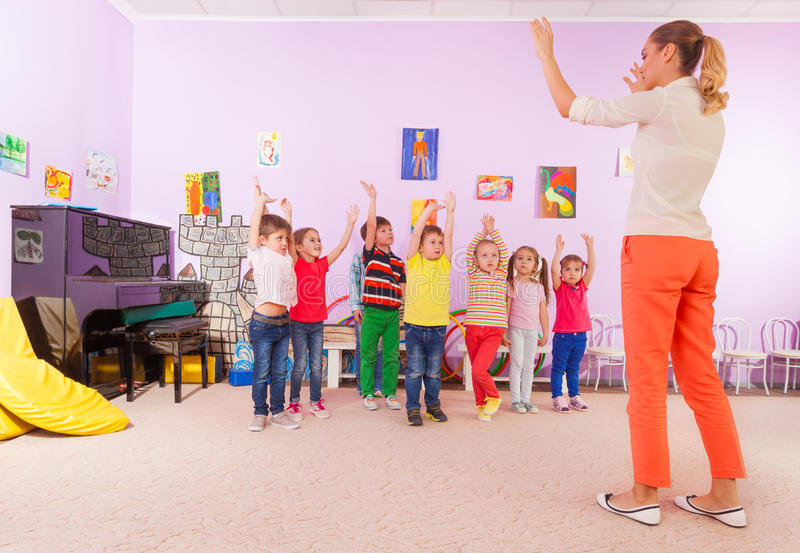 Kids boys and girls in kindergarten sport class royalty free stock photography