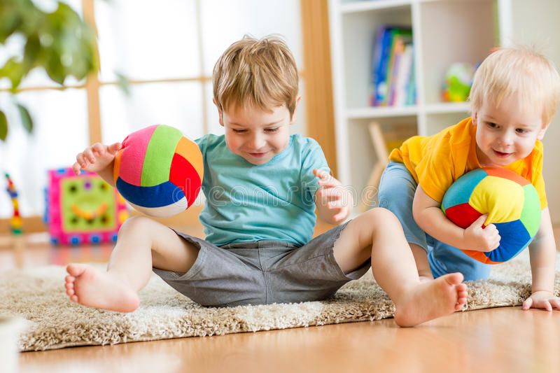 Kids boys play with ball indoor royalty free stock image
