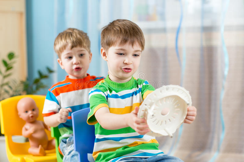 Kids boys playing role game and riding on royalty free stock photo