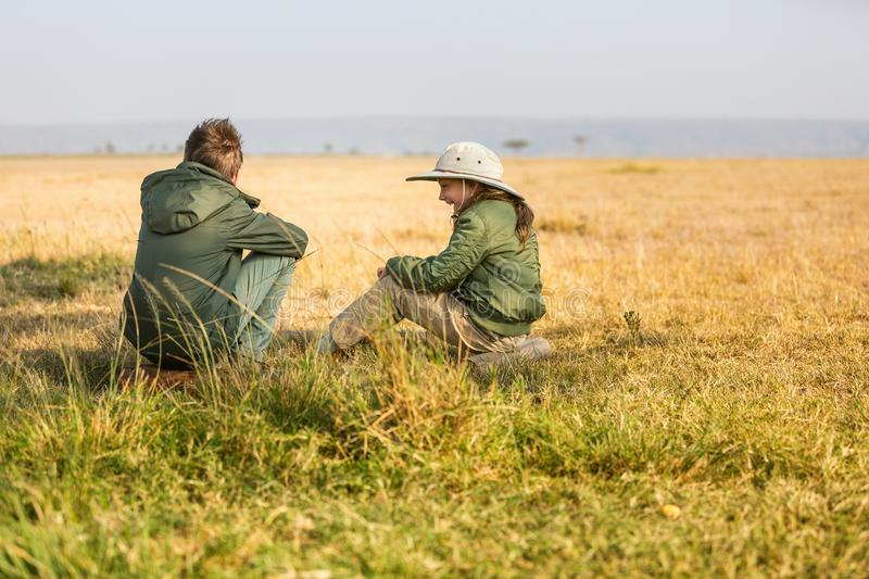 Family safari in Africa. Kids brother and sister on African safari vacation enjoying bush view stock image