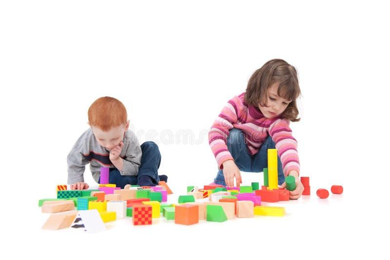 Kids building block towers stock photos