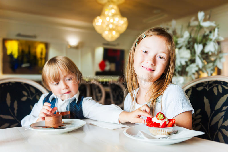 Kids in a cafe stock images