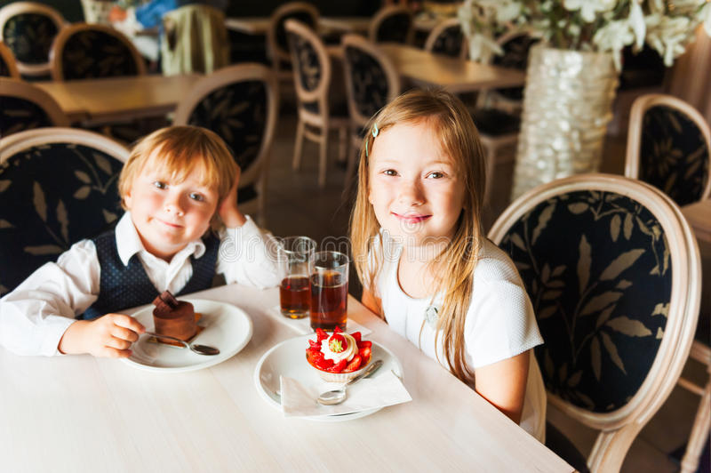 Kids in a cafe royalty free stock photography