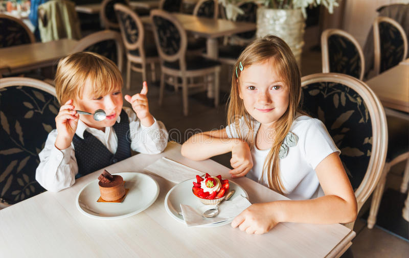 Kids in a cafe royalty free stock photo