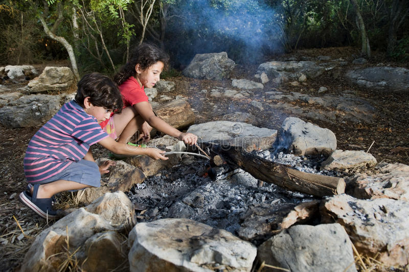 Kids in a campfire stock image