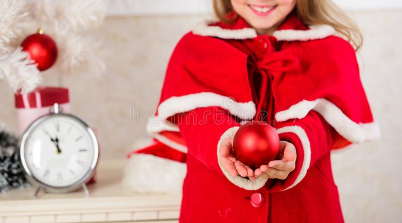 Kids can brighten up christmas tree by creating their own ornaments. Christmas ball traditional decor. Top christmas stock image