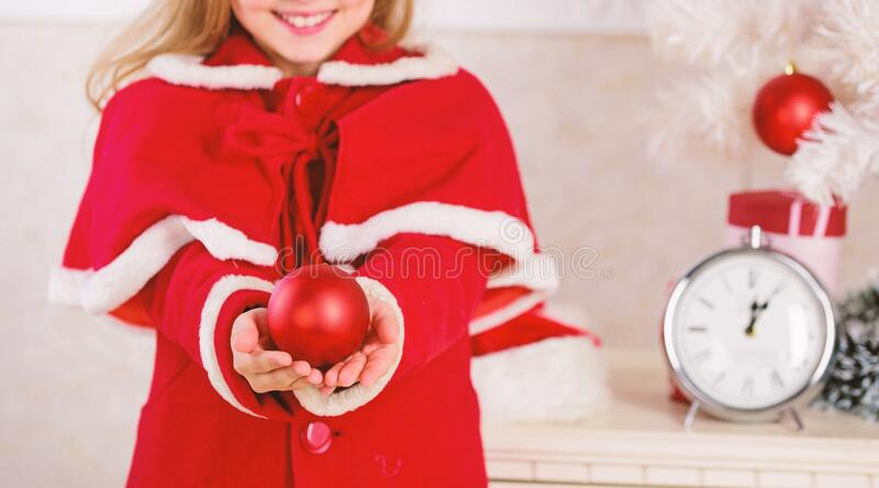 Kids can brighten up christmas tree by creating their own ornaments. Christmas ball traditional decor. Top christmas. Decorating ideas for kids room. Child red royalty free stock image