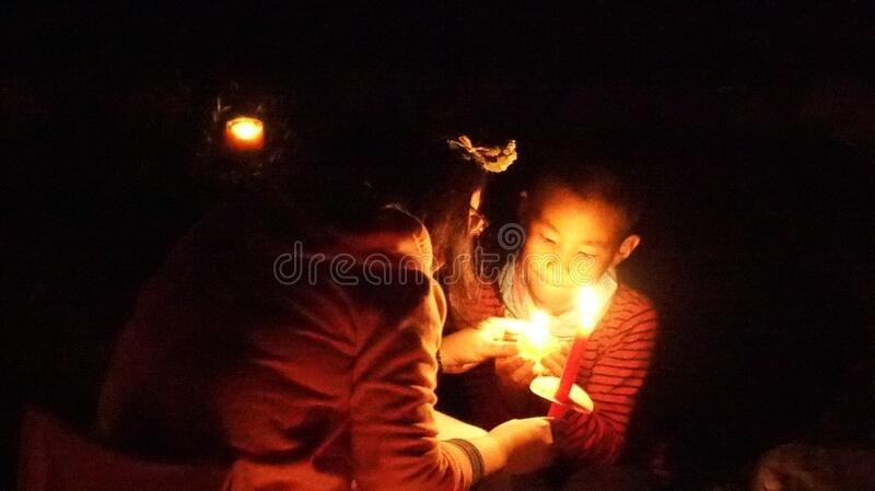 Kids at candlelight ceremony stock image