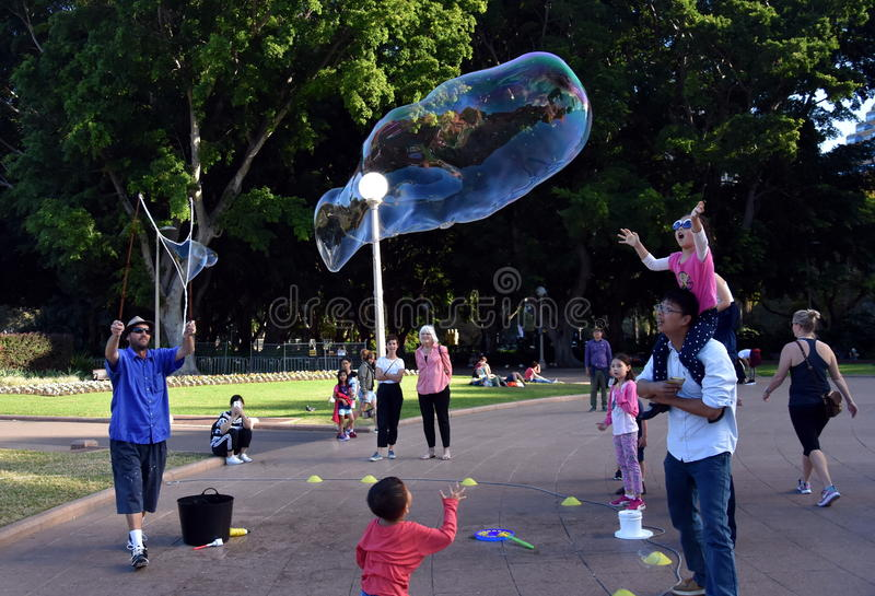 Kids catching and having fun and with soap bubbles royalty free stock photography