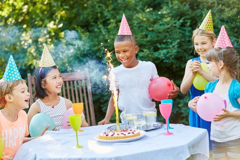 Kids celebrate childrens birthday party. Kids celebrate together childrens birthday party with fireworks stock photos
