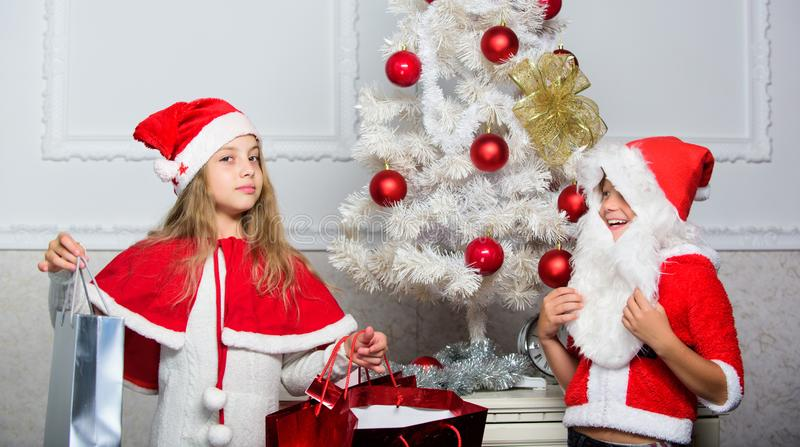 Kids celebrate christmas with gifts. Santa bring christmas gift. Unpacking christmas presents. Reason children love stock images