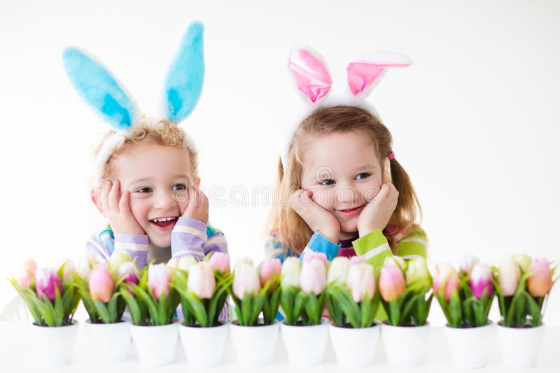 Kids celebrating Easter at home royalty free stock images