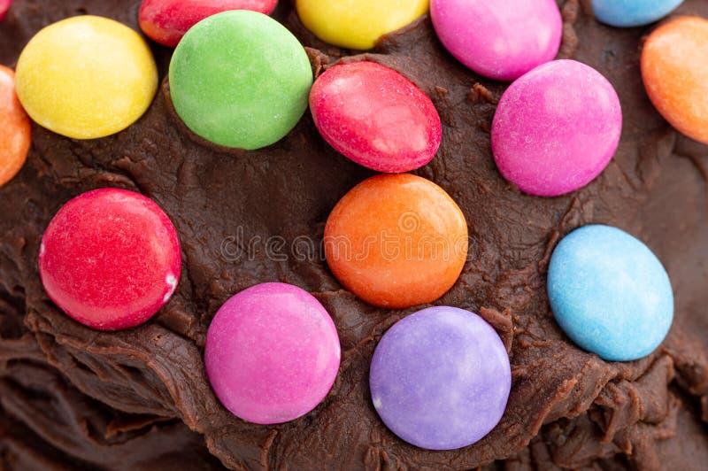 Kids celebration cake. Close up of chocolate bean decoration. royalty free stock photo