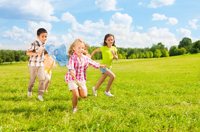 Download Kids chasing butterfly stock image. Image of many, point - 34541243