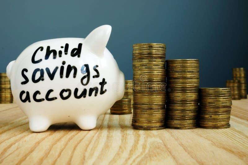 Kids or child savings account written on piggy bank. Kids or child savings account written on side of piggy bank stock photos