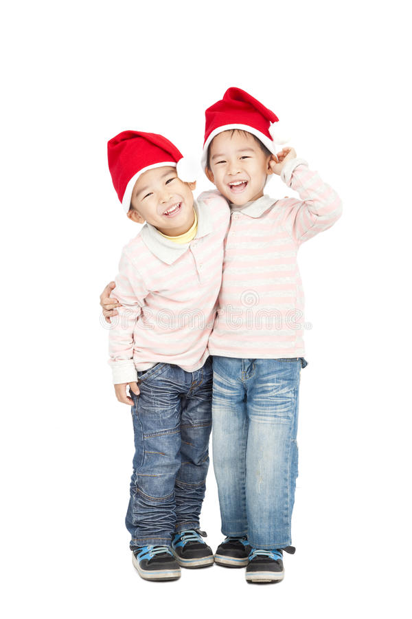 Kids with Christmas hats. Happy asian kids with Christmas hats royalty free stock images